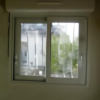Fenêtre coulissante en aluminium avec volet roulant électrique télécommande