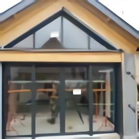 Fenêtres aluminium precadre coulissantes extension bois face