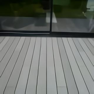 Terrasse bois appui fenêtre lames perpendiculaires