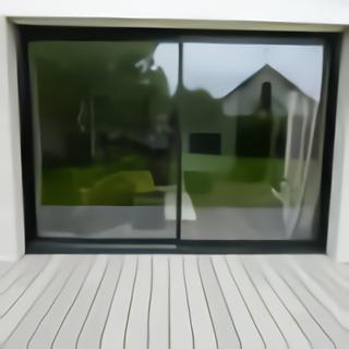 Terrasse bois vue appui fenêtre coulissante