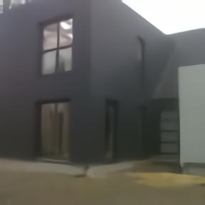 Maison ossature bois menuiseries alu noir sable