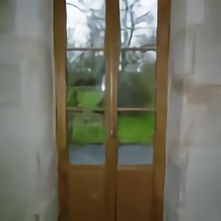 Porte fenêtre en chêne vue intérieure avant finitions